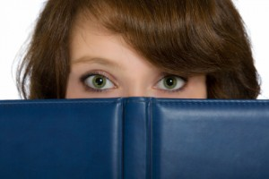 http://www.dreamstime.com/royalty-free-stock-images-beautiful-girl-hiding-behind-blue-open-book-image31692429