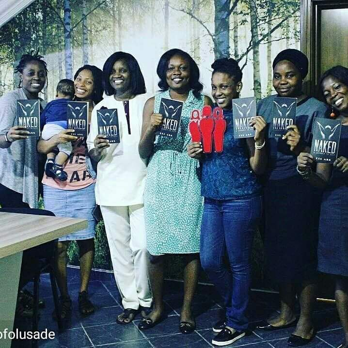 Ese and the women holding copies of Naked