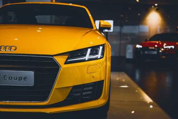 shiny yellow audi car in showroom