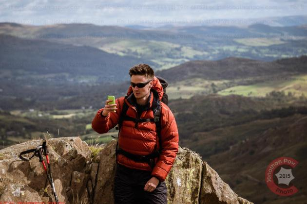 Commercial Photography Sports - A model taking a selfie in the Lake District