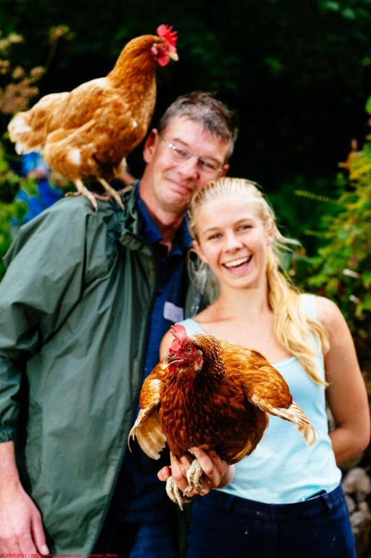 Andy Botham and daughter Jess Botham (18) with their two hens. Andy's hen 'Save our NHS' is a previous world record holder