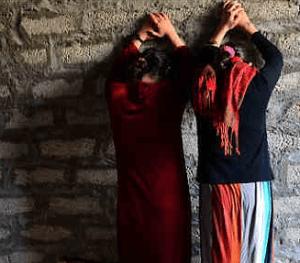 yazidi-women-facing-wall