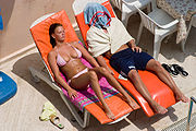 180px-Sunbathing_couple