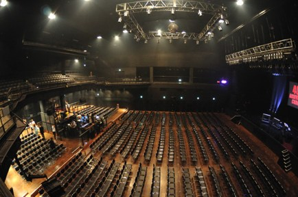 Inside the concert hall, the promoter sits front and center in the balcony...