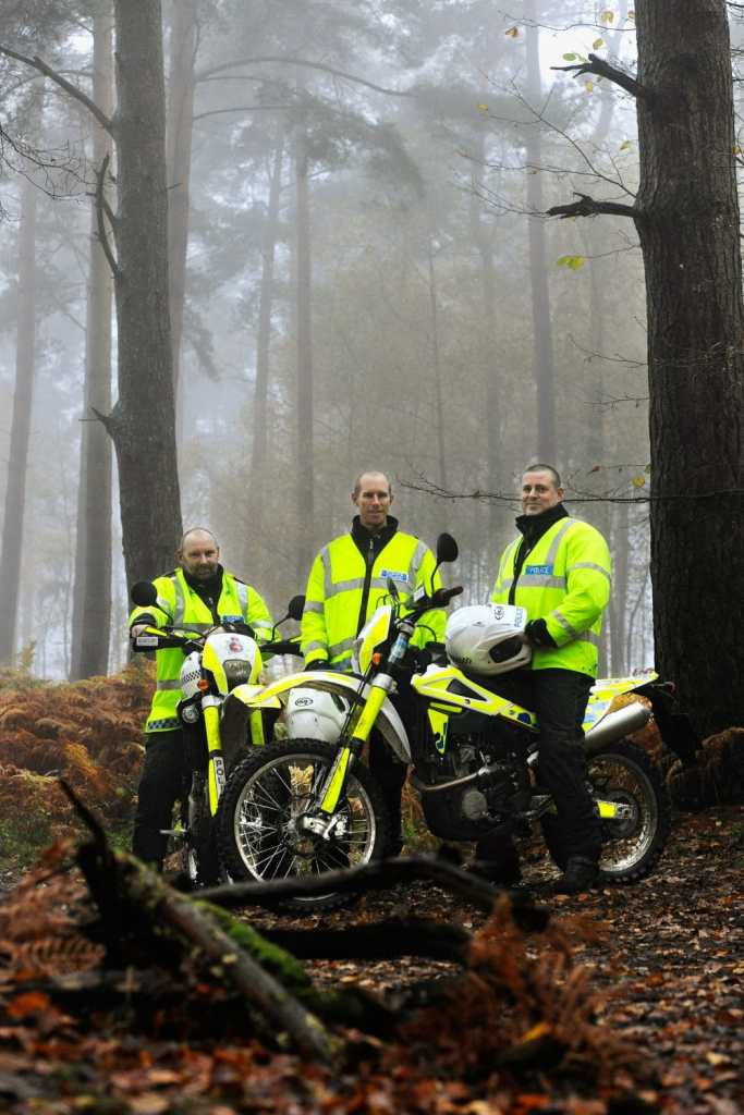 Policemen on motocross bikes patrolling byways