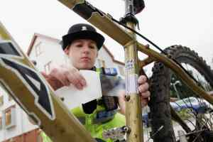 Surrey Police PCSO marking a bicycle