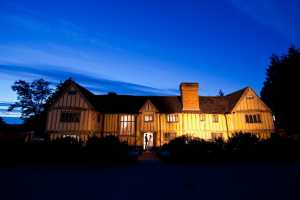 Night time shot of a wedding at Cain Manor, Farnham