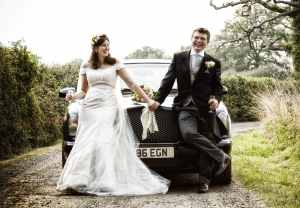 Bride and groom wedding car