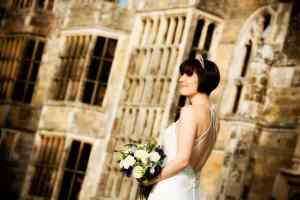 Bride in front of the ruims at the Cowdray Park