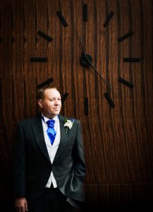 Groom by large clock at Guildford Harbour Hotel