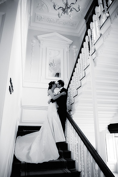 romantic wedding photogaphy on the stairs at Warbrook house