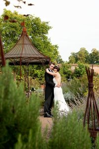 Bride and groom in the Walled Garden at Cowdray
