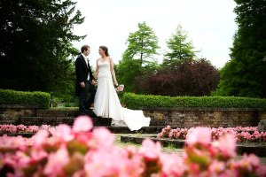 The Bride and Groom in the formal garden, Warbrook House, Hampshire wedding photographer