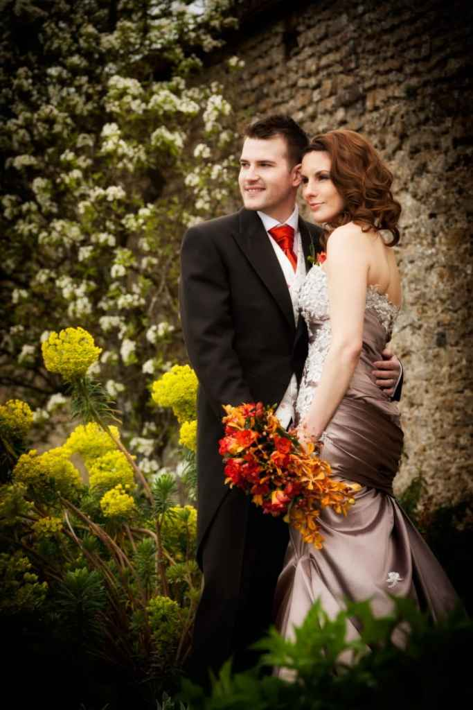 Bride and groom in the spring gardens at Loseley park, Guildford