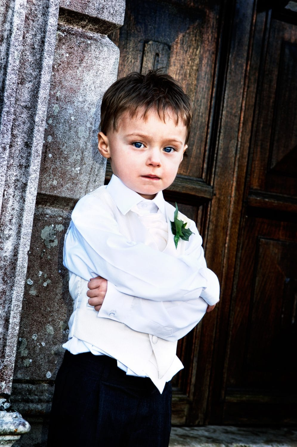 Artistic portrait of a page boy at a Guildford wedding, Loseley park