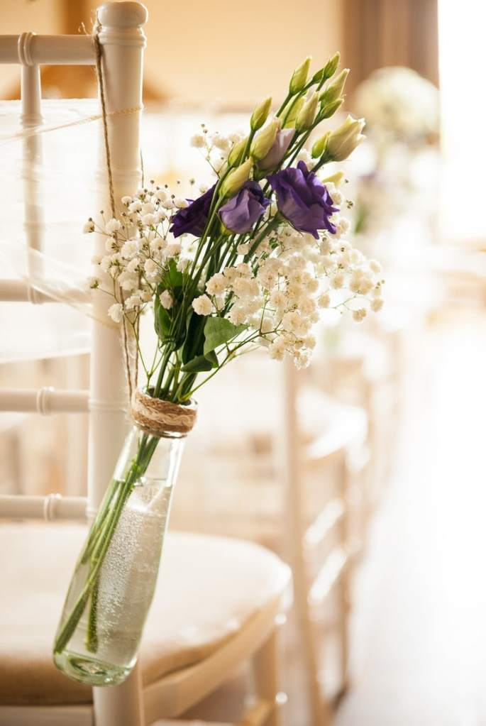 Wedding Aisle Flowers hanging on a chair