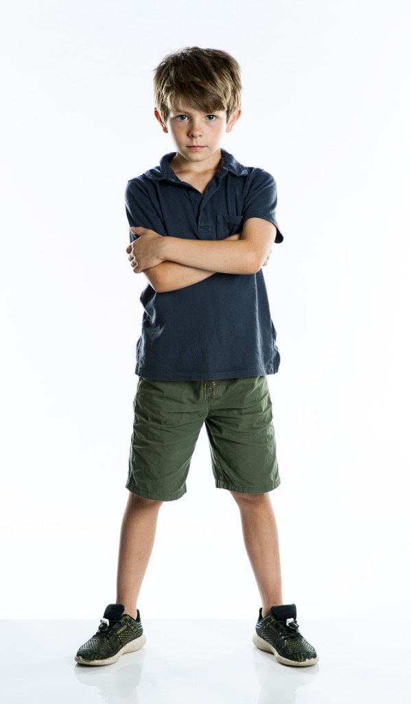 Full length studio portrait of a young bog in shorts and a T Shirt