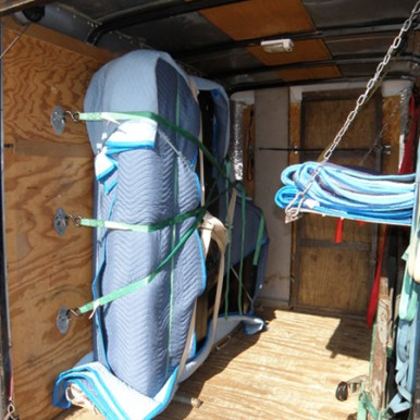Once it is in the trailer, the straps are affixed to the trailer wall so the piano doesn't move during transport.