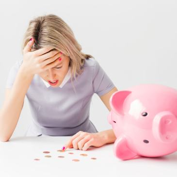 Broke woman counting pennies