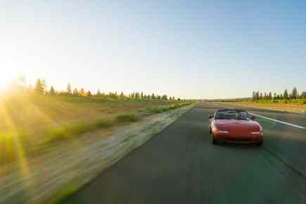 long road red car convertible