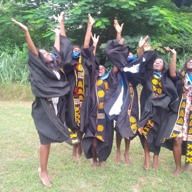 Jullie Jay-Kanz and her colleagues celebrating their graduation
