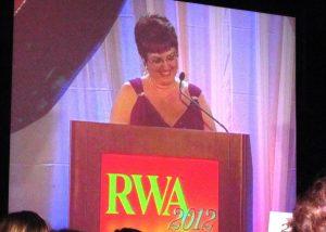 Karen Fleming accepting her Golden Heart Award.