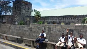 School children near an old church in St. Kitts.