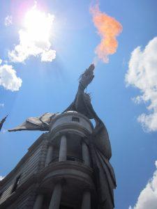 Dragon breathing fire atop Grigott's bank