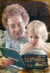 grandmother reading a story to her granddaughter