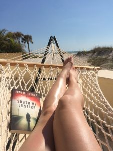 A reader takes South of Justice to the beach.