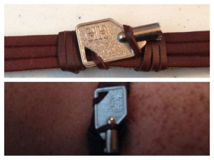 A leather bracelet with a keyboard lock key.