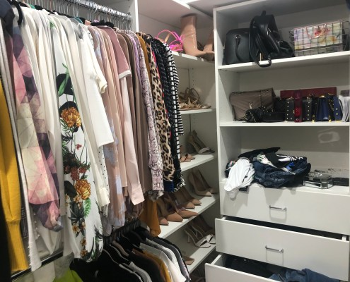 Unorganized closet before I organized