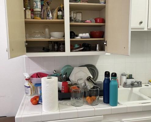 unorganized pantry, unorganized kitchen, messy kitchen shelves, unorganized cabinets, kitchen