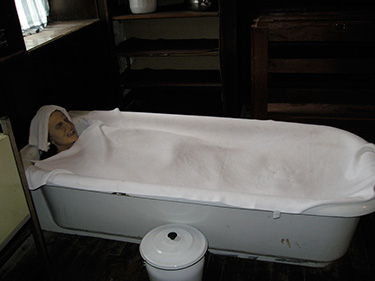 "A bath used to ""calm"" patients by restraining them in a bath of cold or warm water for hours on end."