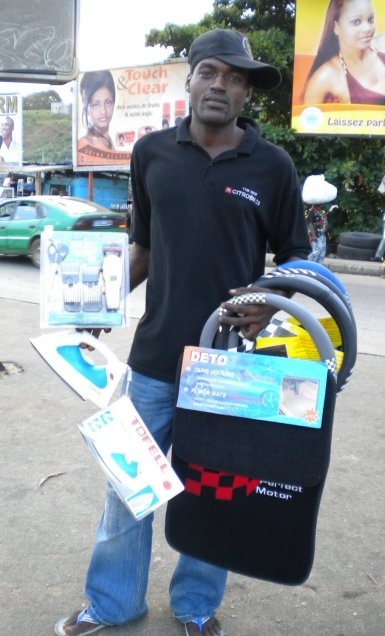 4.- A street vendor shows his wares.