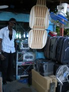 5.- A former mobile street vendor, now moved up to owning his own stall. Other vendors sell his goods.