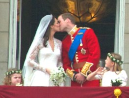 Prince William of England kissing his bride, Kate Middleton