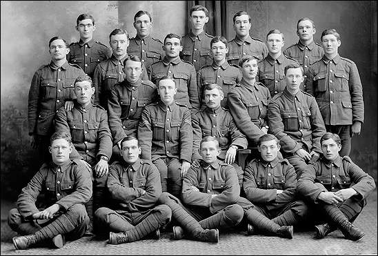 Photo of 22 soldiers in dress uniforms