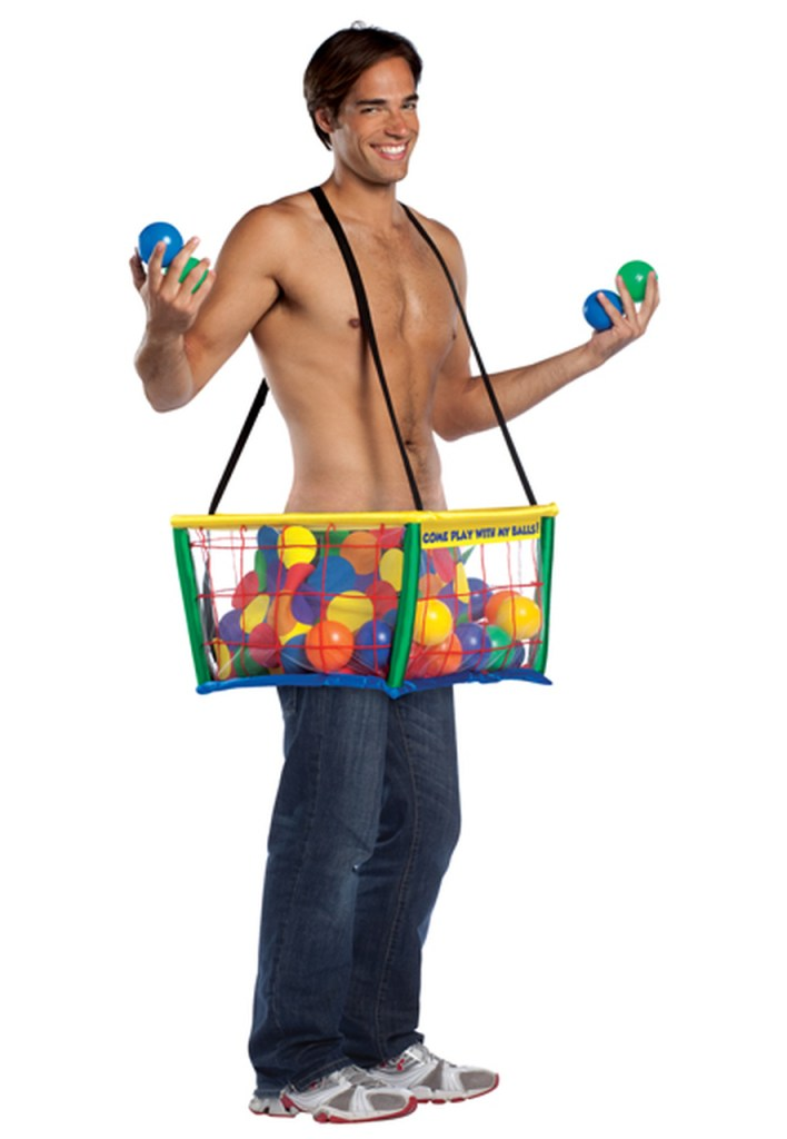 A man with no shirt and a plastic ball pit on his waist, full of plastic balls