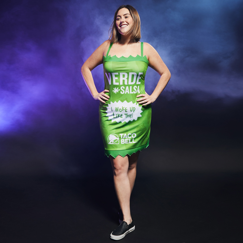 "A woman in a tight green dress labeled ""verde salsa"""