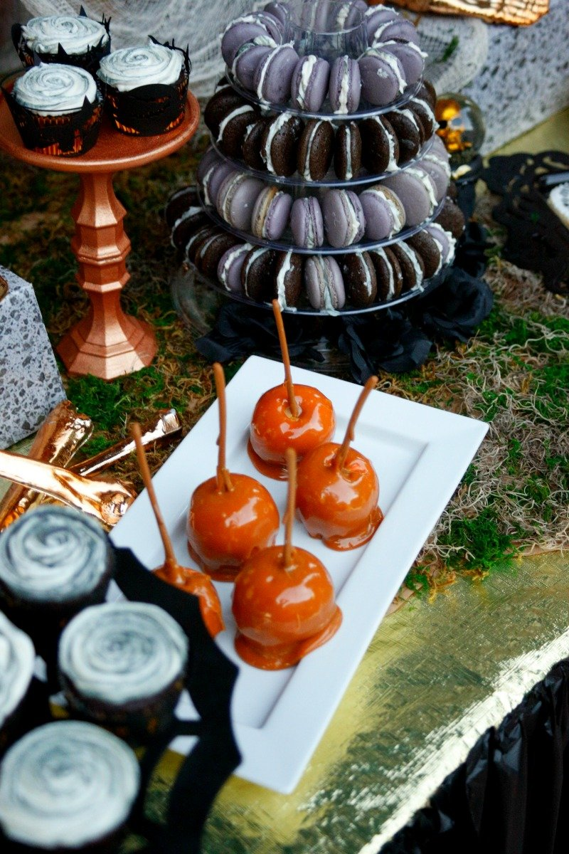 Dessert buffet by Desert Flours Bakery for a creep and beautiful black and gold Halloween dinner party