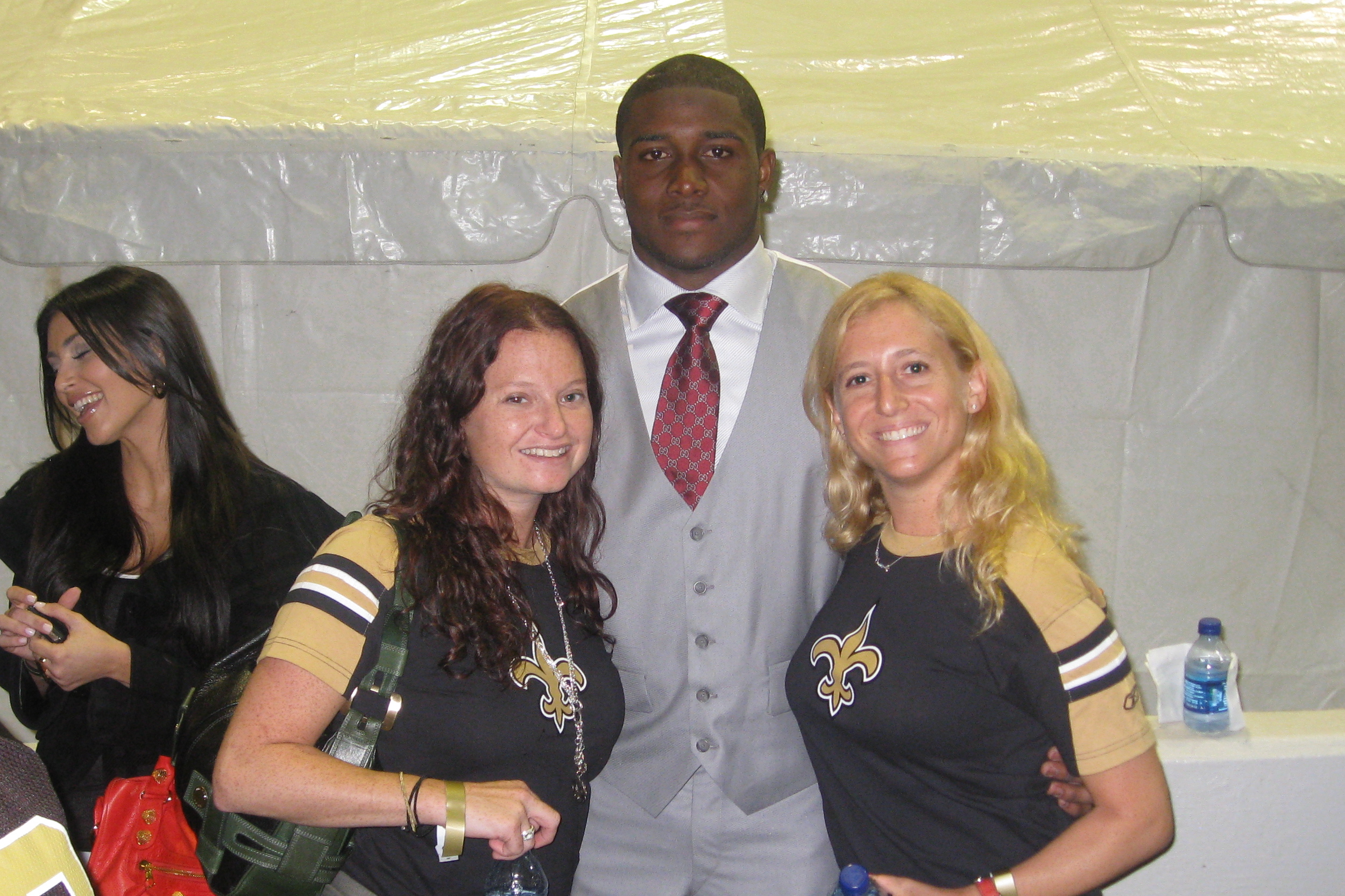 Bryna and Jordan steal a squeeze from Reggie Bush