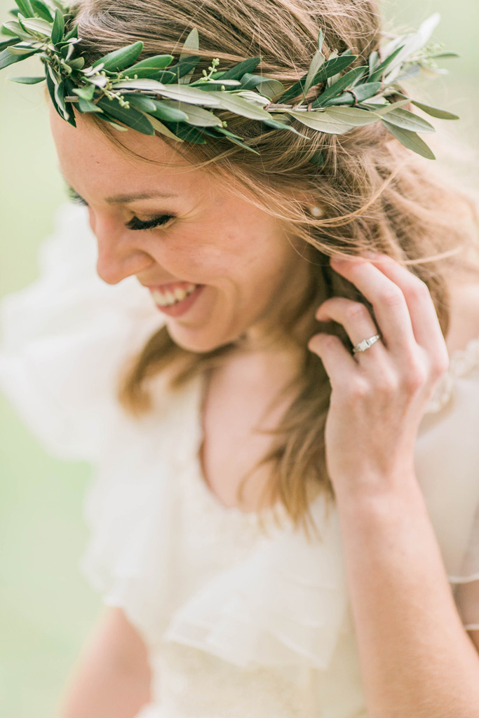 Joyous bride in olive leaf crown. Flowers and styling Jessica Ormond Events. Photography Emily Koontz.