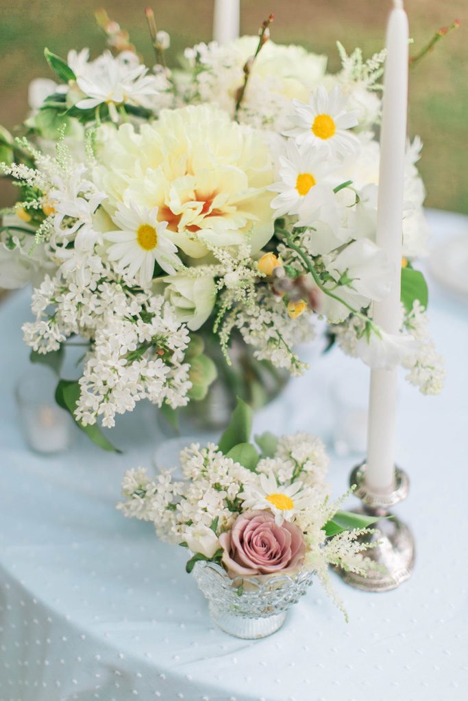Yellow garden style centerpiece. Yellow tree peony. Daisy. Lilac. Flowers and styling Jessica Ormond Events. Photography Emily Koontz.