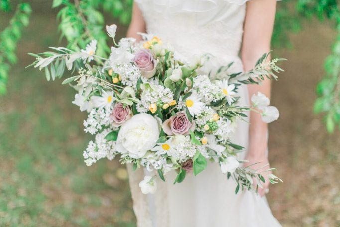 Wild, romantic bouquet with peonies, roses, and lilacs. Flowers and styling Jessica Ormond Events. Photography Emily Koontz.
