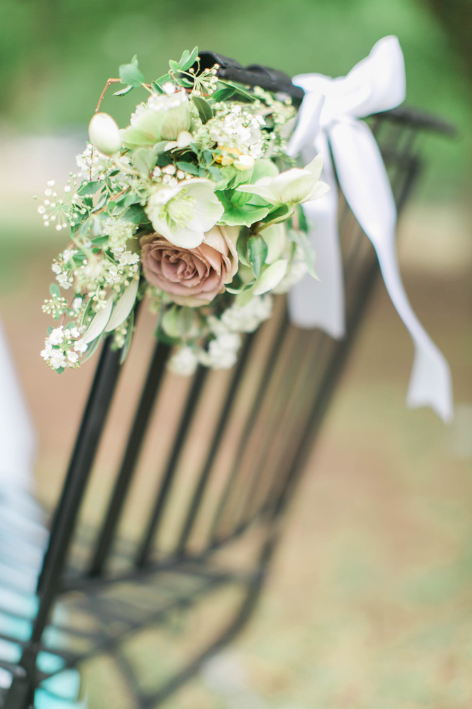 Sweet wedding chair flowers. Texas wedding florist. Flowers and styling Jessica Ormond Events. Photography Emily Koontz.