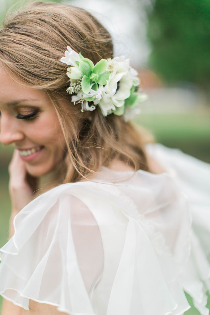 Joyous bride with spring flowers in her hair. Flowers and styling Jessica Ormond Events. Photography Emily Koontz.