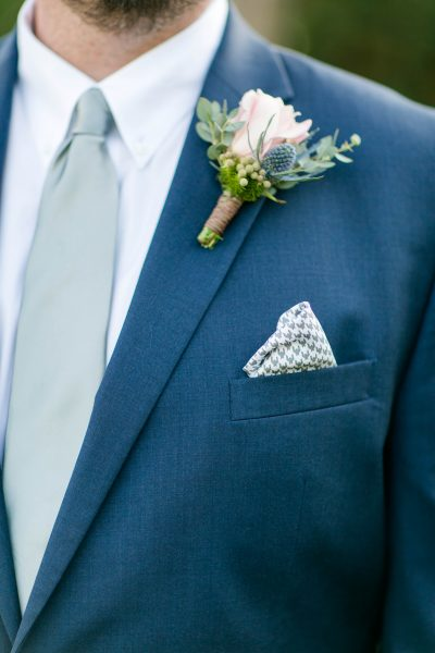 Thistle and pink rose boutonniere. Design by Jessica Ormond Events. Photo by Allee J Photography.