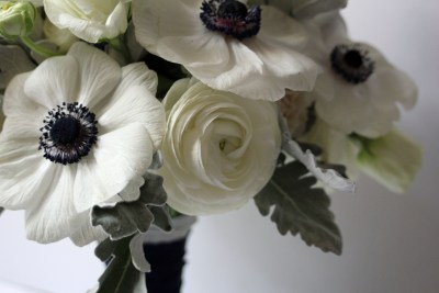 Close up of Anenomes, Ranunculus, and Dusty Miller by Lubbock wedding florist Jessica Ormond Events