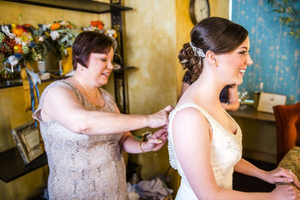Mother helping bride get ready at McPherson's Cellars in Lubbock Texas. Caitlin & Ryan Photography.